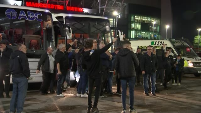 manchester old trafford ext manchester city fans celebrating after match reporter to camera - damon green stock videos and b-roll footage