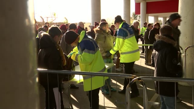 highlights / french national anthem played england hertfordshire watford vicarage road ext fans queuing to get into stadium with police officers in... - 列に並ぶ点の映像素材/bロール