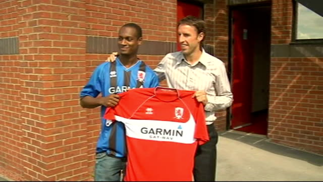middlesbrough unveil justin hoyte england middlesbrough rockcliffe park training ground ext justin hoyte posing in middlesbrough football shirt hoyte... - middlesbrough stock videos and b-roll footage