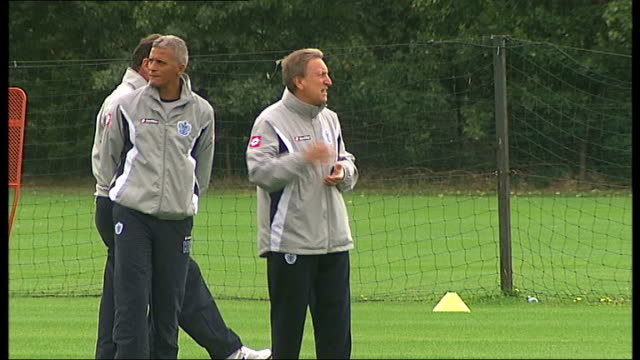 Premier League preview / QPR return to the top division Middlessex Harlington Queens Park Rangers players training QPR manager Neil Warnock at...
