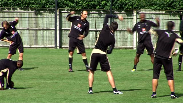tottenham hotspur training / press conference england essex chigwell spurs lodge ext tottenham hotspur fc players on training pitch being watched by... - tottenham hotspur f.c stock videos & royalty-free footage