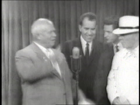 premier nikita khrushchev talks to vice president richard nixon at a meeting - 1959 stock-videos und b-roll-filmmaterial