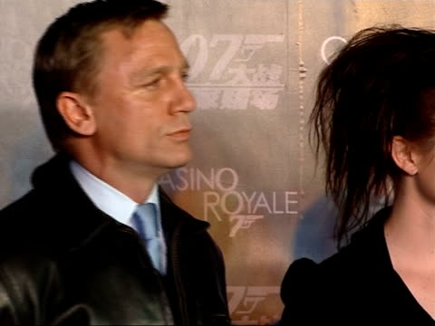 premiere of casino royale takes place in beijing with new bond daniel craig in attendance brief shot of craig green campbell broccoli and wilson on... - crucifers stock videos & royalty-free footage