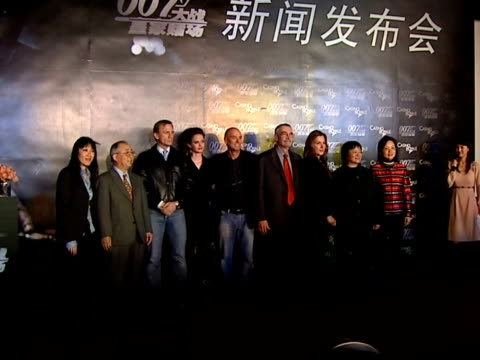 premiere of casino royale takes place in beijing with new bond daniel craig in attendance; various of group photos on stage / craig and green leave - première stock videos & royalty-free footage