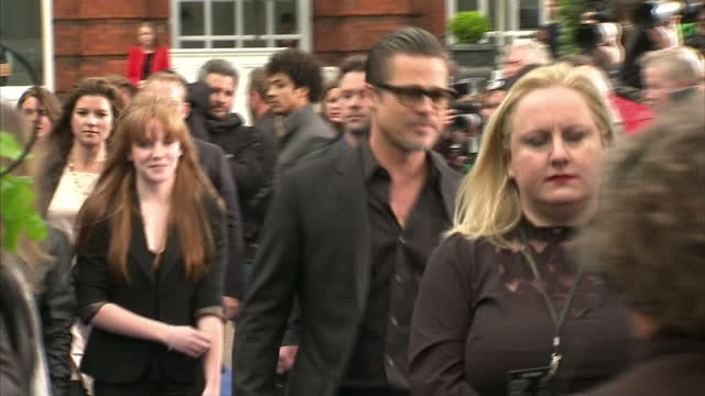 Premiere of Maleficent at Kensington Palace last night Shows exterior shots of Brad Pitt and Angelina Jolie and their eldest son Maddox mingling...