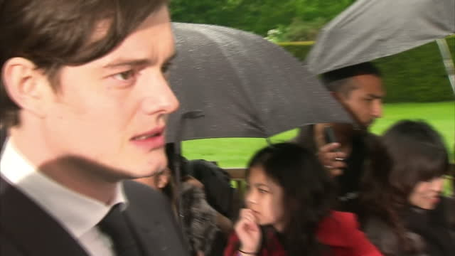 Premiere of Maleficent at Kensington Palace last night Shows exterior shots of actor Sam Riley signing autographs on the red carpet and being...