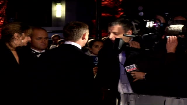 Premiere of new James Bond film 'Casino Royale' Craig on red carpet hugging Michael Wilson and speaking to press