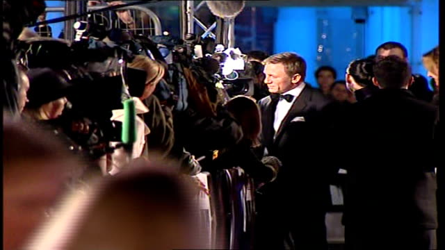 Premiere of new James Bond film 'Casino Royale' Craig signing autographs posing for photographers and speaking to press