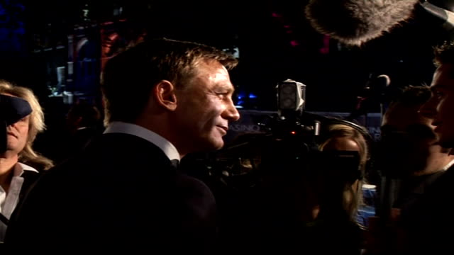Premiere of new James Bond film 'Casino Royale' Daniel Craig speaking to press as holds hands with Mitchell