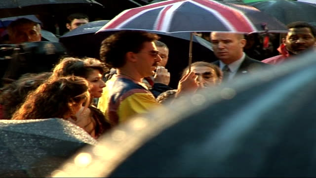 premiere of sacha baron cohen's film 'borat' 'borat' standing in crowd with fans and press as takes microphone and addresses crowd sot greets crowd... - borat sagdiyev stock-videos und b-roll-filmmaterial