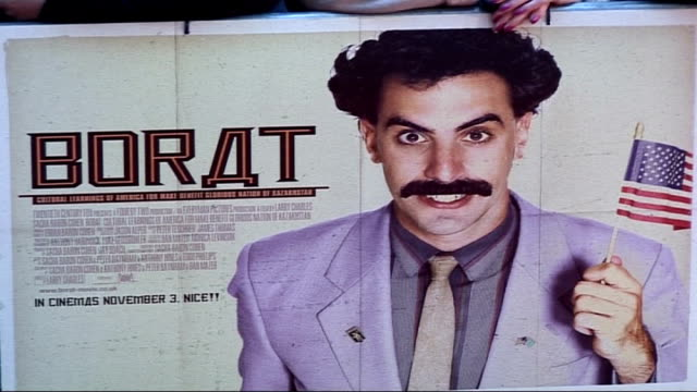 premiere of sacha baron cohen's film 'borat' england london leicester square close up of poster for 'borat' film attached to railing and fans waiting... - borat sagdiyev stock-videos und b-roll-filmmaterial