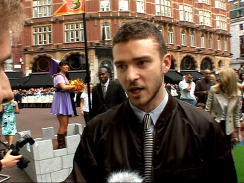 premiere of 'shrek the third': red carpet interviews; timberlake speaking to press / justin timberlake interview sot - enjoys movies and music /... - justin timberlake stock videos & royalty-free footage