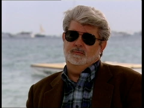 vídeos de stock, filmes e b-roll de revenge of the sith at cannes george lucas interview sot i like to make movies i don't like to talk about them/ when i did star wars none of this... - george lucas
