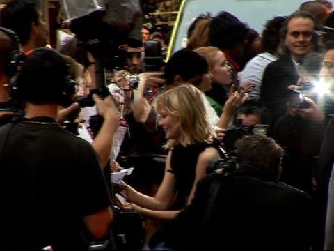 premiere of third 'spiderman' film red carpet interviews kirsten dunst posing on red carpet / dunst signing autographs * * flash photography * * /... - sleeveless dress stock videos and b-roll footage