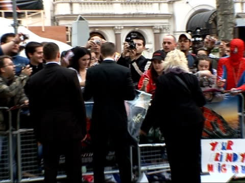 premiere of third 'spiderman' film red carpet interviews topher grace signing autographs / giant screens showing maguire speaking on stage pan... - topher grace stock videos & royalty-free footage