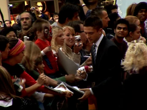 premiere of third 'spiderman' film red carpet interviews topher grace signing autographs on red carpet - topher grace stock videos & royalty-free footage