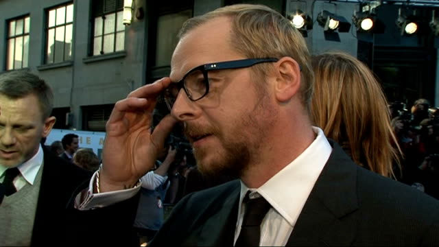premiere of tintin film simon pegg interview sot on playing characters of thompson and thomson with nick frost / on edgar wright / on motion capture... - daniel craig actor stock videos and b-roll footage