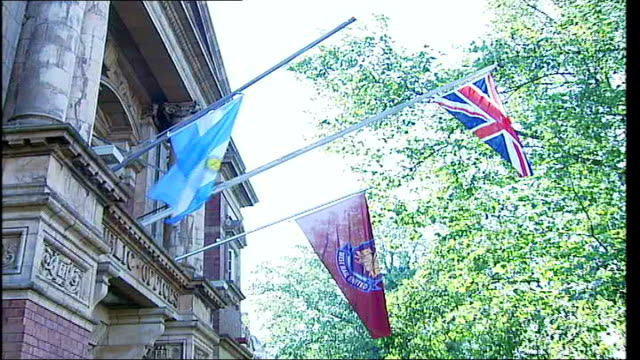 London Newham EXT Low angle view of Argentina flag hoisted out on flagpole outside Newham Council building ZOOM IN West Ham fan along wearing...