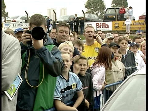 Leeds Elland Road Row of stewards facing group of Leeds United fans GV Manchester United team coach arriving as fans boo Rio Ferdinand SOT...
