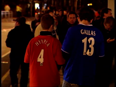 London Stamford Bridge Chelsea and Liverpool fans along to ground Young fans one wearing Hyypia shirt and the other wearing Gallas shirt Football...