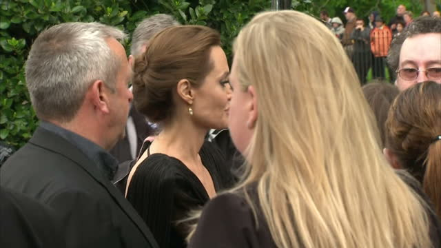 Premire or Maleficent at Kensington Palace last night Shows exterior shots of Brad Pitt having his picture taken with fans on the red carpet and...