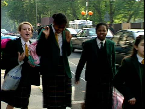 prep school students in uniform walking down street in the uk - school uniform stock videos & royalty-free footage
