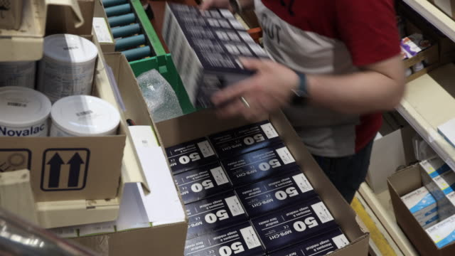 preparation by ocp, n°1 in france for distribution, boxes of 50 anti-projection masks which will be distributed to health professionals by pharmacies... - mascherina chirurgica video stock e b–roll