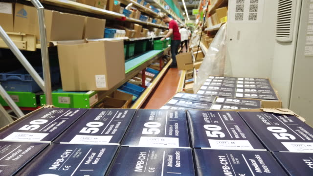 preparation by ocp n°1 in france for distribution boxes of 50 antiprojection masks which will be distributed to health professionals by pharmacies /... - mundschutz stock-videos und b-roll-filmmaterial