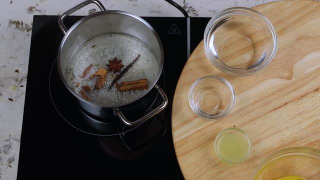 preparation caramel sauce - boiling stock videos & royalty-free footage