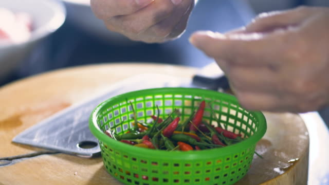 preparation : chili in the kitchen , super slow motion - peperone video stock e b–roll