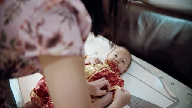 preparation for chinese new year - baby clothing stock videos & royalty-free footage