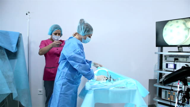 preparation for hysteroscopy surgery. - operating gown stock videos & royalty-free footage