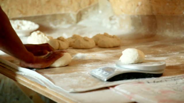 preparation for making flat bread, kneading the dough - tortilla flatbread stock videos & royalty-free footage