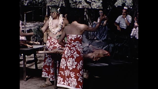 1960 kalua pork preparation  - home movie - polynesian culture stock videos and b-roll footage