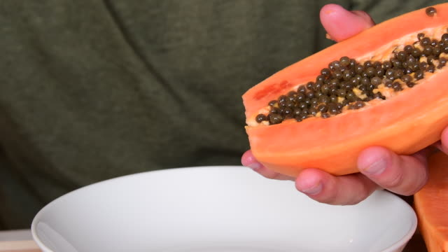 preparation of a papaya fruit for eating - red delicious stock videos & royalty-free footage