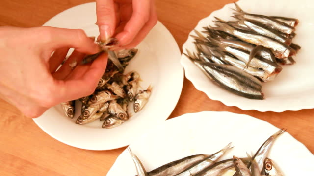 preparation of anchovies - female beheading stock videos & royalty-free footage