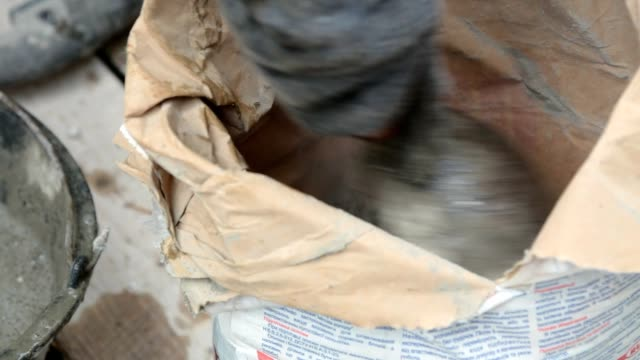 preparation of building glue in a bucket. - cement stock videos & royalty-free footage