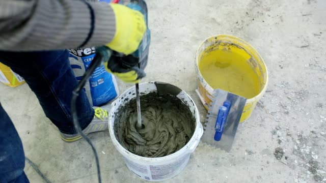 preparation of building glue. - drill stock videos & royalty-free footage