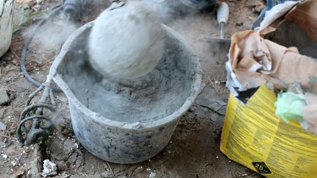 preparation of building mortar. - plaster stock videos and b-roll footage