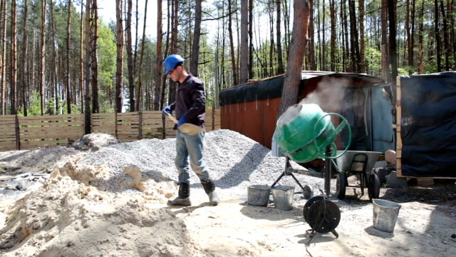 preparation of concrete in a concrete mixer. - general view stock videos & royalty-free footage