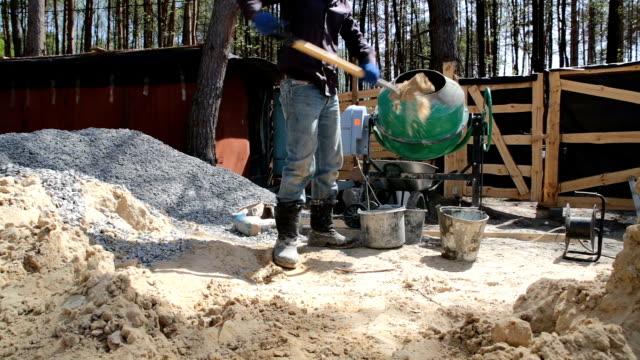 Preparation of concrete in a concrete mixer.