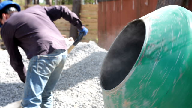 preparation of concrete in a concrete mixer. - concrete stock videos & royalty-free footage