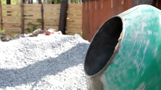 preparation of concrete in a concrete mixer. - cement mixer stock videos and b-roll footage