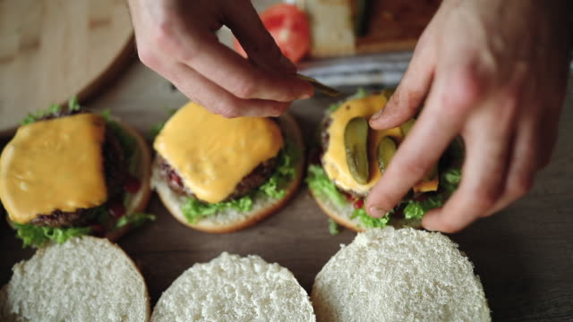 preparation of delicious hamburgers - burger stock videos and b-roll footage