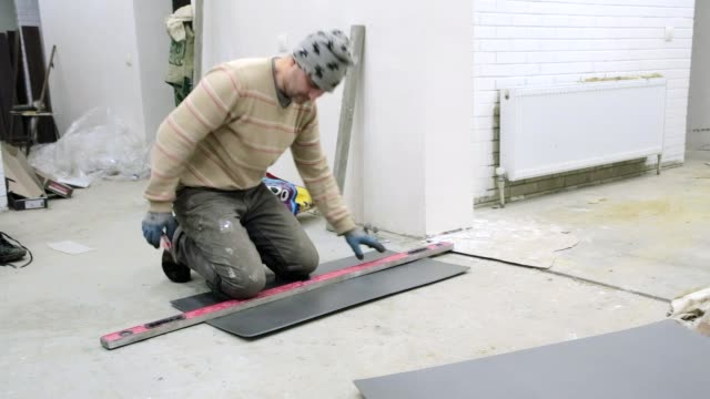 preparation of insulation material for flooring. - insulator stock videos & royalty-free footage