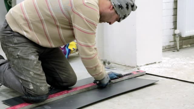 preparation of insulation material for flooring. - measuring stock videos & royalty-free footage