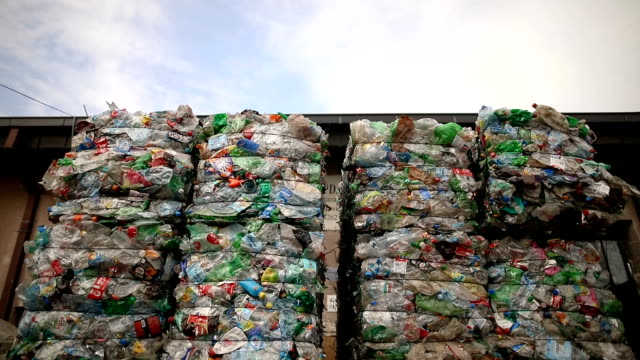 preparation of plastic bottle.garbage for recycling.plastic bales of rubbish at the waste treatment processing plant. recycling separate and storage of garbage for further disposal, trash sorting. business for sorting and processing of waste - bundle stock videos & royalty-free footage