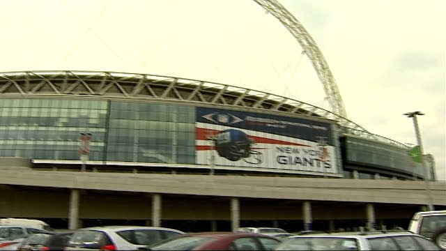 preparations at wembley stadium for nfl match; england: london: wembley: ext exterior of wembley stadium with giant banner advertising american... - nfc east stock videos & royalty-free footage