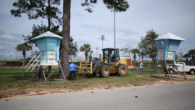preparations before hurricane michael's landfall in panama city beach florida usa on tuesday august 2018 - cabina del guardaspiaggia video stock e b–roll