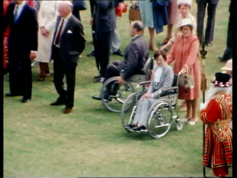 preparations england london buckingham palace gv buckingham palace ts people in wheel chairs at palace garden party ts lady diana and prince charles... - buckingham palace stock videos & royalty-free footage
